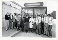 People posing in front of special TTC bus