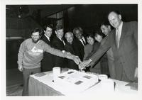 Principal Paul Thompson, MPP Alvin Curling, Councillor Ron Moeser and others cutting UTSC's 25th Anniversary cake