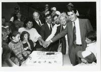 Principal Thompson cutting a cake in celebration of the opening of N'Sheemaehn Child Care Centre with Councillor Ron Moeser, Scarborough Mayor Joyce Trimmer and others