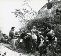 Students attending outdoor lecture (bluffs?)