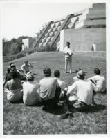Students taking class outside in front of the science building