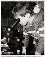 Child looking through a microscope, Science Open House