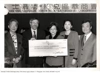 Principal Paul Thompson receiving a cheque for $10,000 from Chinese Business Association