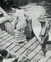 Malay Unloading his Baggage at Sandakan