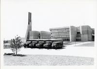 Exterior of UTSC with buses and drivers in front