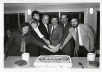 Principal Thompson, Councillor Ron Moeser and others cutting a cake celebrating the opening on the North Village Centre, November 23 1990