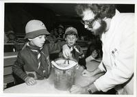 Boy Scouts performing science experiment