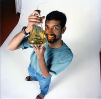 Promotional photograph of man with chemistry beaker; Arvan (?) Governor General Award 1998