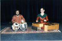 Two students playing the tabla and wooden xylophone
