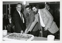 MPP Frankford, Councillor Ron Moeser and Principal Paul Thompson cut the cake at the opening of Phase III Residences