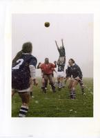 Female students playing rugby in the snow