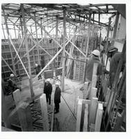 Construction of original Andrews building, view of steel scaffolding and construction worker