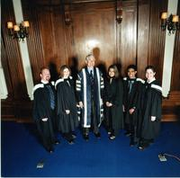 Birgeneau with students in convocation robes