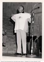 Principal D.R. Campbell with T-shirt in Meeting Place
