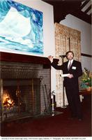 Principal Paul Thompson in front of Doris McCarthy painting over the fireplace at Miller Lash house