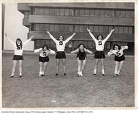 Women's Cheerleading Team in Front of Administration Building